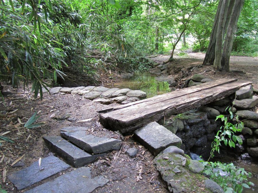 A footbridge over a waterfall.