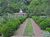 Walkway from center to west side with rose garden on left.