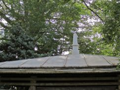 Obelisk on roof of tea house.