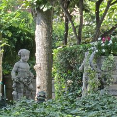 The statues throughout the garden are original to the house.