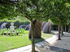 The sculpture intertwines with the hornbeams.