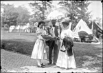 Florence Kimball and her escort being offered food at a 1908 Governor's Island lawn party.  Both G.I. photos by Bains News Service.