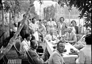 A tea party for the Jerusalem YMCA after a tennis tournament, August 1939, by the American Colony of Jerusalem.