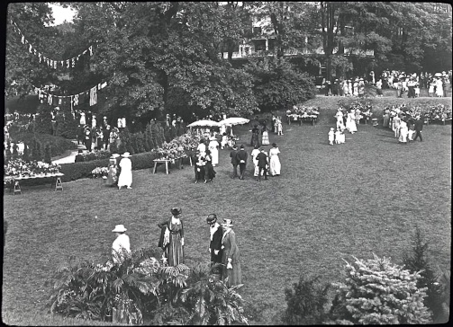 "Garden party at the Hartsdale Train Station in the Bronx, Sept. 20, 1919. The event was ""Floralia."" Photo by Bronx Parkway Commission."
