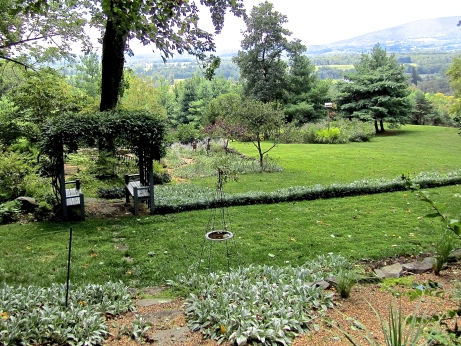 The garden and view from the patio on the first of three terraces. A small pond is hidden by the arbor.