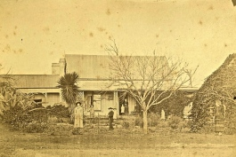 Gardening at the front of Aloe Villa, Toowoomba, ca. 1900. There is a bush-house on the right (and a massive agave on the left).