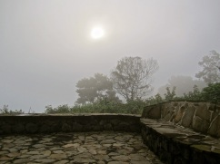 The stone terrace of our cabin in morning fog.