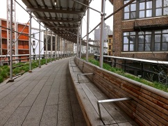 A long stretch of bench with scaffolding.