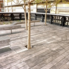 The lines of the benches repeat those of the decking.