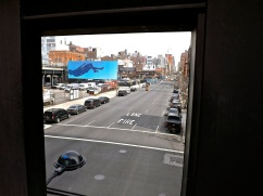 The blue billboard is art commissioned for the H.L.