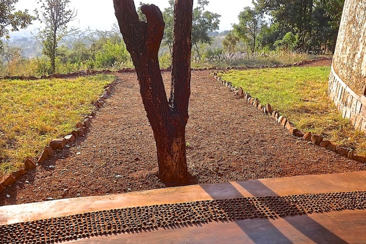 Pebble floor border, welcome center, Akagera Nat'l. Park in Rwanda:enclos*ure