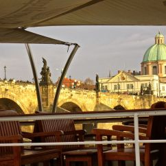 The sun briefly turned the 15th c. Charles Bridge gold just as a tour boat arrived.