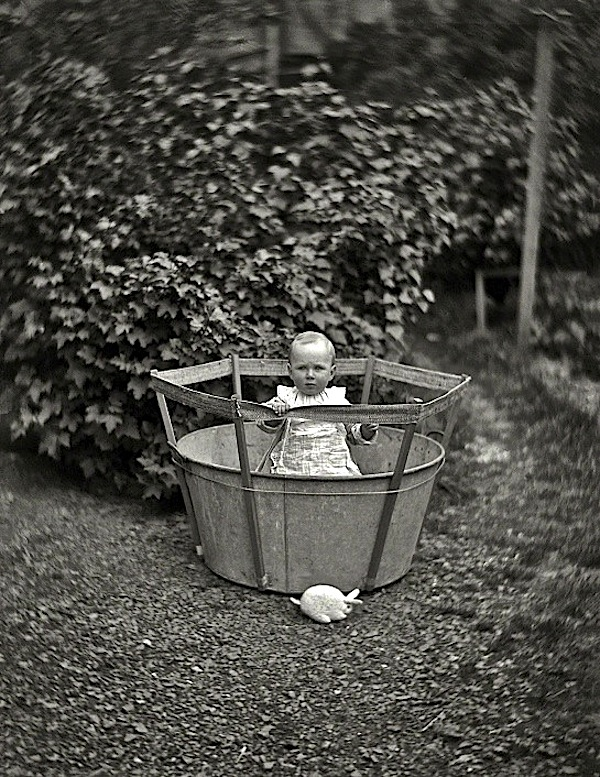 Baby in bucket, by W. Williams, via Shorpy