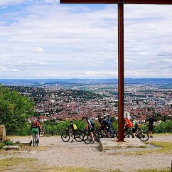 A steel cross and the view of the city.