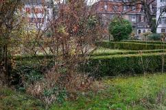Beneath shrubs, paths,. . .