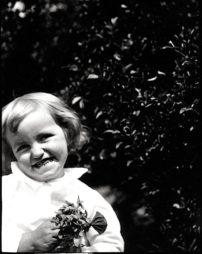 Child with violets cropped, ca. 1900, Mississippi Dept of Archives and History
