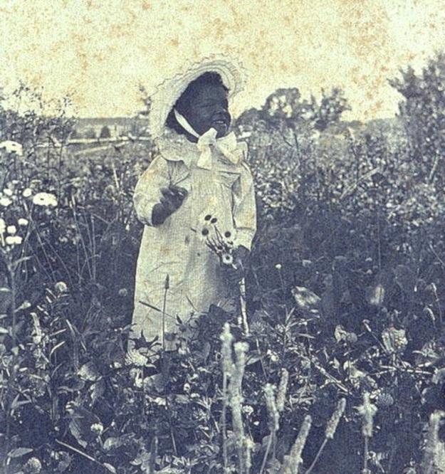 Girl in flower field, Library of Congress